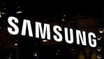 A logo sits illuminated outside the Samsung pavilion on the opening day of the World Mobile Congress at the Fira Gran Via Complex on February 22, 2016 in Barcelona, Spain.
