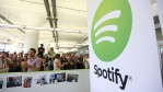 People gather in Spotify offices following a press conference.
