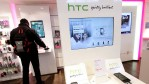 HTC phones lie on display at a shop of German telecommunications provider Deutsche Telekom.