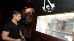 Actor Garrett Clayton playing the Sony PlayStation 4.