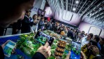 Visitors check new ZTE devices on the opening day of the World Mobile Congress at the Fira Gran Via Complex.