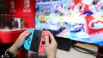 A guest enjoys playing Mario Kart 8 Deluxe on the groundbreaking new Nintendo Switch at a special preview event in New York on Jan. 13, 2017.