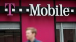A pedestrian walks by a T-Mobile store on April 24, 2017 in San Francisco, California. T-Mobile will report first quarter earnings today after the closing bell.