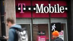 Pedestrians walk by a T-Mobile store on April 24, 2017 in San Francisco, California. T-Mobile will report first quarter earnings today after the closing bell.