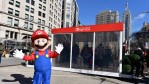 In this photo provided by Nintendo of America, Mario makes a guest appearance at the Nintendo Switch in Unexpected Places activation at Madison Square Park in New York.